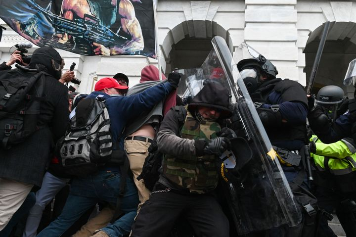 Riot police push back a crowd of supporters of then-President Donald Trump after they stormed the Capitol building on Jan. 6
