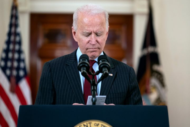 In a speech at the White House on Monday, President Joe Biden reads the number of Americans who have died of COVID-19.