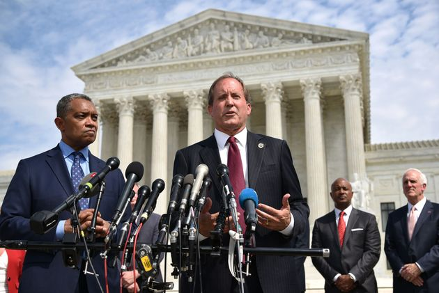 Texas Attorney General Ken Paxton (center) traveled to Utah last week during the winter storms that claimed...