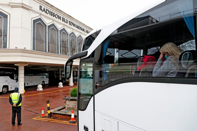 A woman arrives in a coach at the Radisson Blu hotel, where travellers are spending their mandatory hotel...
