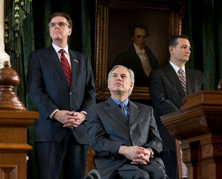 Texas' incoming Lt. Gov. Dan Patrick (left) and Gov. Greg Abbott listen, alongside Sen. Ted Cruz, during transition ceremonies at the Texas Capitol in January 2015.