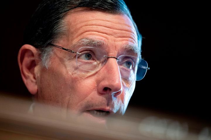 Sen. John Barrasso (R-Wyo.) questions Haaland at a committee hearing on her nomination.