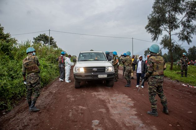 KIBUMBA, DEMOCRATIC REPUBLIC OF THE CONGO - FEBRUARY 22: UN peacekeepers and Congolese armed forces stand...