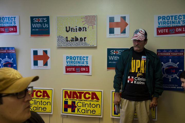 Union workers Johnathan Brown, a member of IBEW Local 26, left, and Guy Martin meet before going out to canvas Virginia neigh