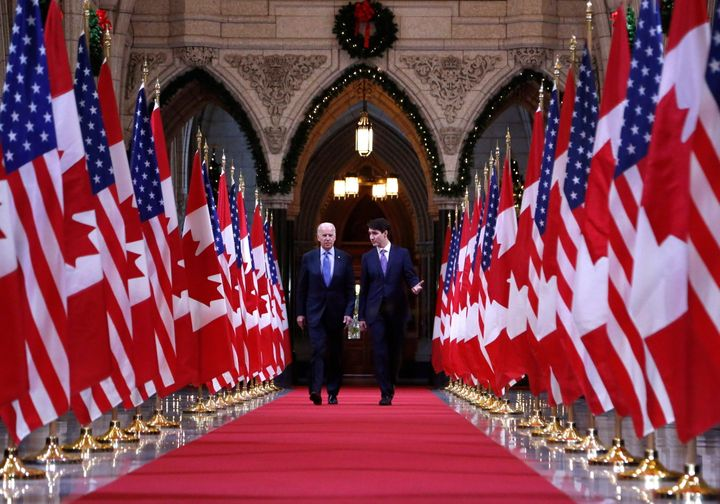 File photo of Prime Minister Justin Trudeau and U.S. Vice-President Joe Biden walking down the Hall of Honour on Parliament Hill in Ottawa on Dec. 9, 2016.