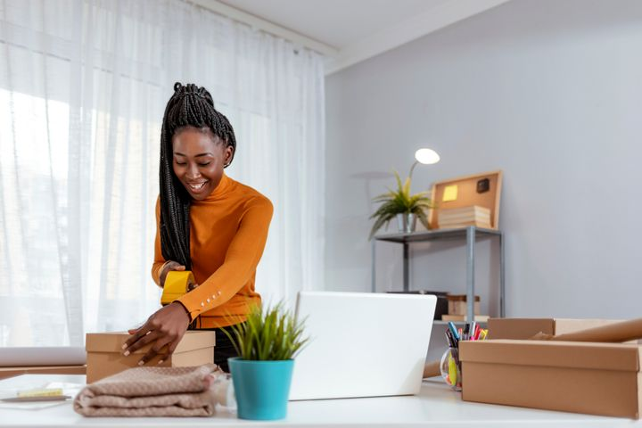 Woman packing at home