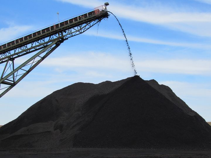 Coal from an underground mine in Muhlenberg County, Kentucky, pours off the end of a conveyor onto a pile used to load trucks for delivery in December 2018.