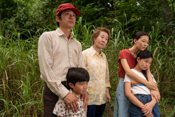 "Steven Yeun, Alan Kim, Youn Yuh-jung, Han Ye-ri and Noel Cho in ""Minari."""