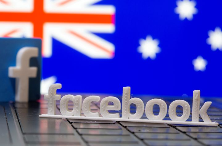 A 3D printed Facebook logo is seen in front of displayed Australia's flag in this illustration photo taken February 18, 2021.