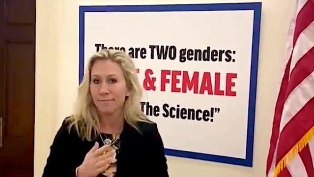 Marjorie Taylor-Greene Antagonizes Democratic Colleague With Anti-Transgender Sign.jpg