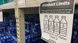 "A ""Product Limits' sign is seen next to water shelves in a supermarket in Houston, Texas following winter storm Uri that left millions without power and caused water pipes to burst, on February 20, 2021. - Texas authorities have restored power statewide bringing relief after days of unprecedentedly frigid temperatures, but millions were still struggling on February 20, 2020 without safe, drinkable water. (Photo by Francois PICARD / AFP) (Photo by FRANCOIS PICARD/AFP via Getty Images)"