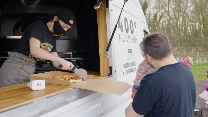Customers getting takeaway from 400° Pizzeria
