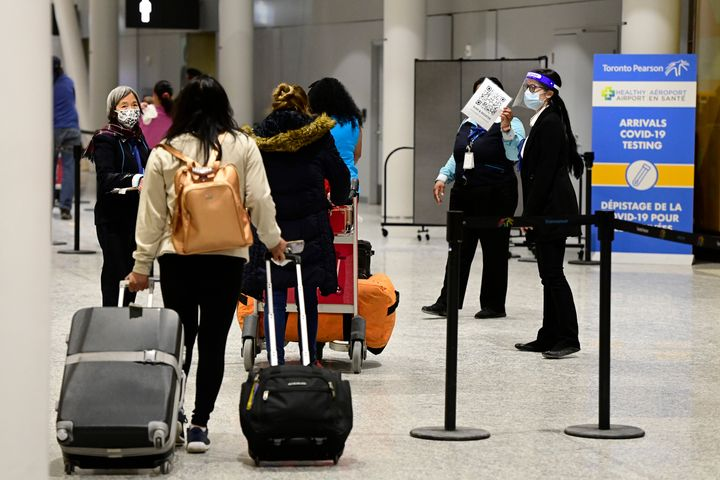 Travellers arrive at Terminal 3 at Toronto Pearson International Airport in Mississauga, Ont., on Feb. 22, 2021. Some international travellers are refusing to follow the new travel rules that kicked in this week.