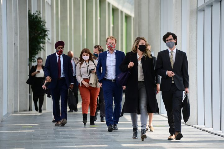 Minister of National Defence Harjit Sajjan, left to right, Minister of Indigenous Services Marc Miller, and Minister of Economic Development and Official Languages Melanie Joly and staff leave on the third and final day of the Liberal cabinet retreat in Ottawa on Sept. 16, 2020.
