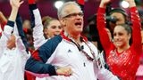 U.S. women's gymnastics coach John Geddert celebrates during the final rotation in the Artistic Gymnastics Women's Team final at the 2012 London Olympics.