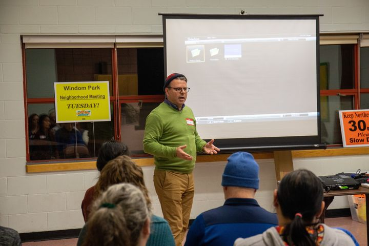 Kim Havey, Minneapolis' municipal sustainability director, voted for the first time in 2019 for the ICC model energy code set to take effect this year. He's seen here speaking about his city's climate goals to a group of residents.