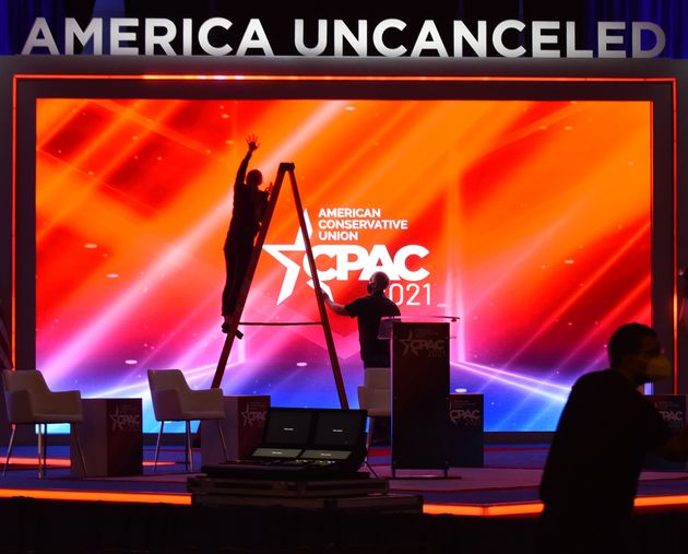 ORLANDO, FLORIDA, UNITED STATES - 2021/02/25: Workers prepare the stage for the opening of the 2021 CPAC...