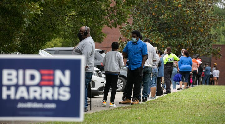 People stand in line on the first day of early voting for the general election at the C.T. Martin Natatorium and Recreation C
