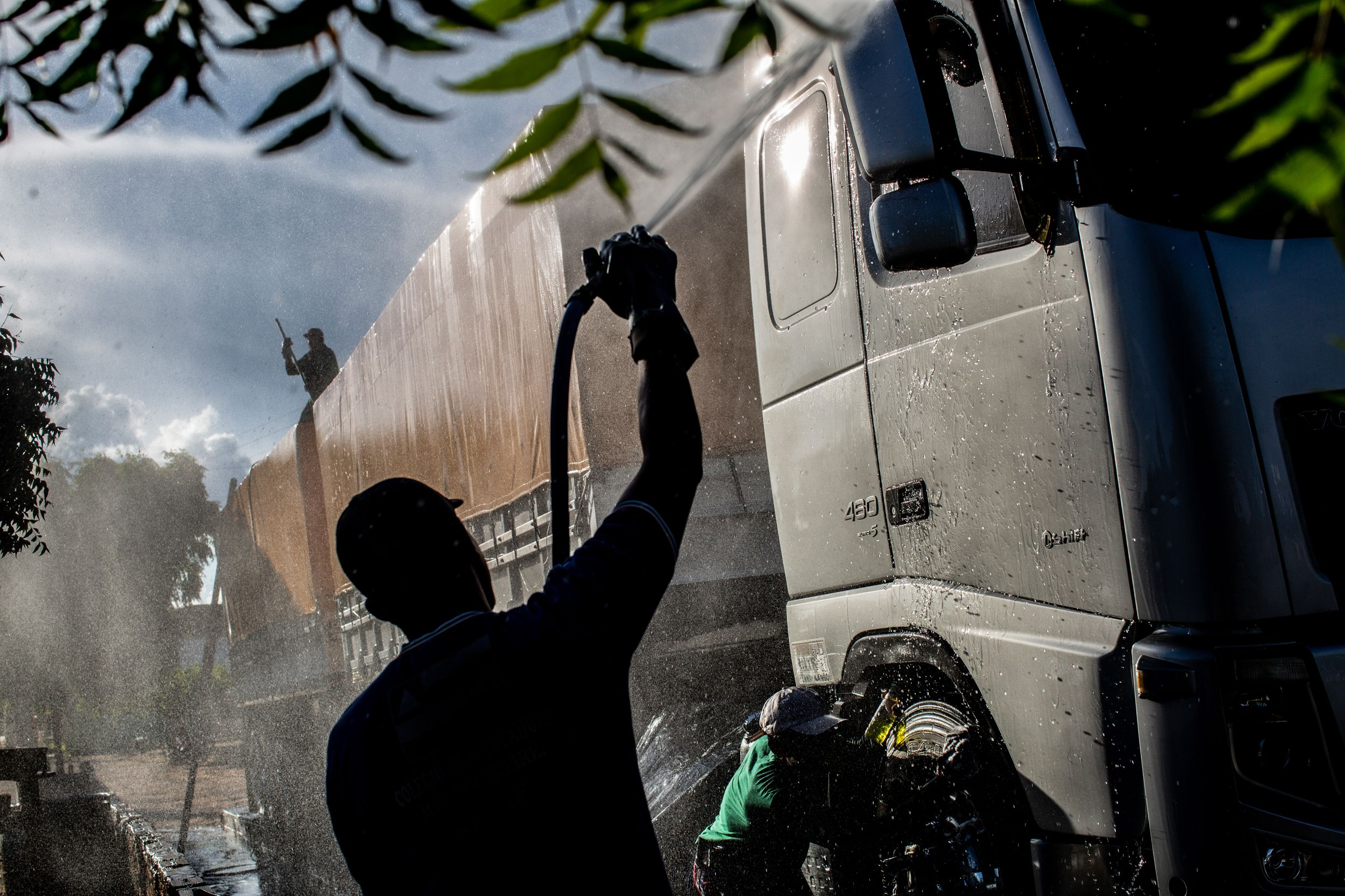 Workers clean a soy truck near Barreiros in Bahia.