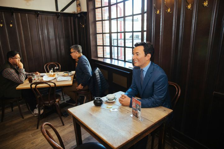 A wax statue of comedian Jimmy Fallon occupies a table at the steakhouse.