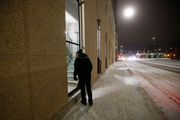 Peter Oyeniyi, van outreach worker with the Salvation Army Extreme Environment Response Vehicle checks a Winnipeg parkade staircase where the homeless stay in the early hours of Saturday morning on Feb. 2, 2019.