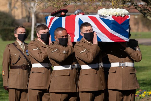 The coffin of Captain Sir Tom Moore is carried by members of the armed forces during his funeral at Bedford