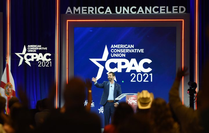 Donald Trump, Jr. waves as he leaves the stage after addressing attendees at the 2021 Conservative Political Action Conferenc