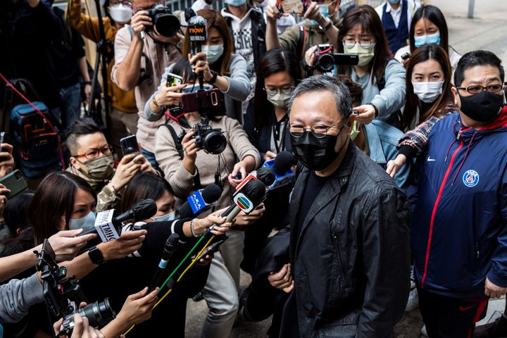 Hong Kong law professor and pro-democracy activist Benny Tai (C) speaks to the press outside Ma On Shan police station in Hon