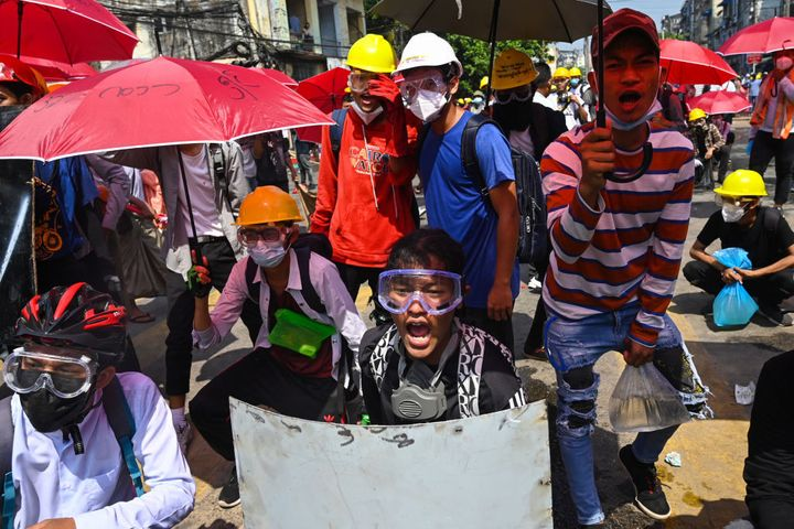 Protesters react during a demonstration against the military coup in Yangon on March 1, 2021.