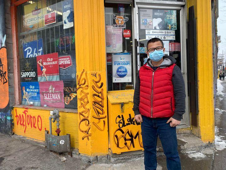 Wenjun Mo outside of his Montreal depanneur.