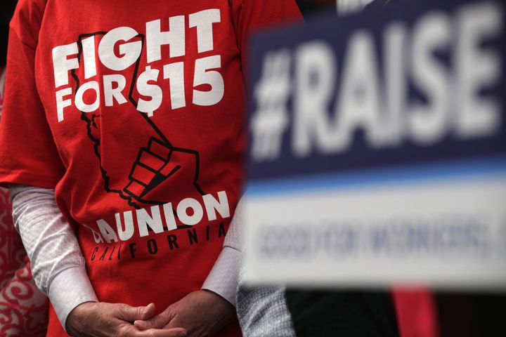 """An activist wears a """"Fight For $15"""" T-shirt prior to a vote on the Raise the Wage Act at the U.S. Capitol on July 18, 2019. P"""