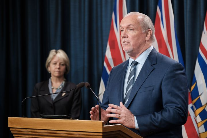 B.C. premier John Horgan and chief medical officer Dr. Bonnie Henry speak at a news conference on Mar. 1, 2021.