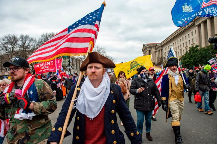 Trump supporters sporting an array of looks head toward the Capitol after he delivered an incendiary speech at a rally on the National Mall.