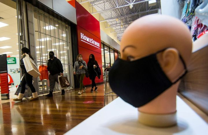 People wearing face masks are seen at Vaughan Mills shopping mall in Vaughan, Ont., Nov. 18, 2020. Canada's economy got off to a strong start in January, despite a record decline in 2020.