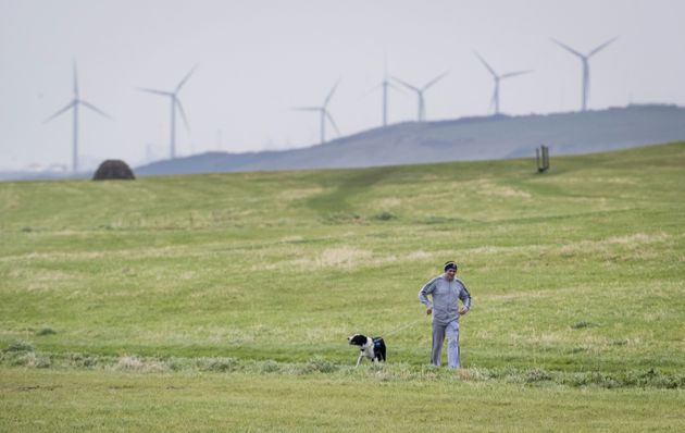 A man walking his dog near Whitehaven in Cumbria, where the proposed mine will be