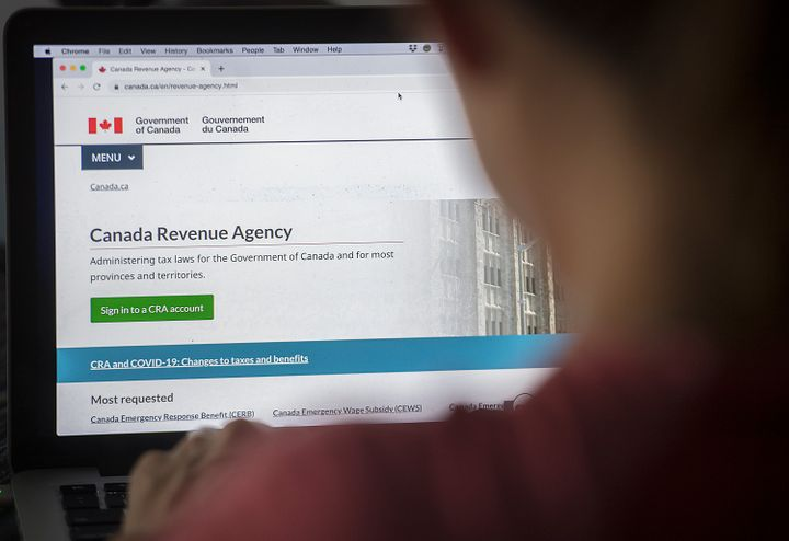 A person looks at a Canada Revenue Agency homepage in Montreal on Aug. 16, 2020.