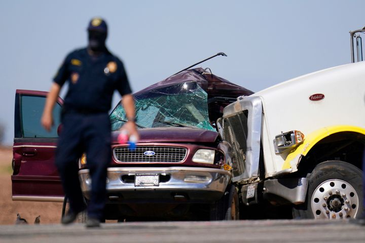 Law enforcement officers work at the scene of a deadly crash in Holtville, California, on Tuesday.