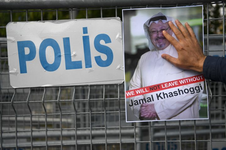 A protester holds a picture of Khashoggi, whose body has never been found, during a demonstration in front of the Saudi Arabi