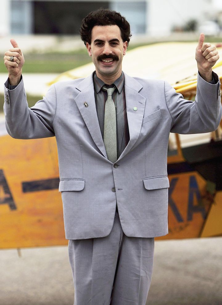 "Sacha Baron Cohen playing the part of his comedy character ""Borat"" lands at a private airfield on November 2, 2005 in Lisbon,"