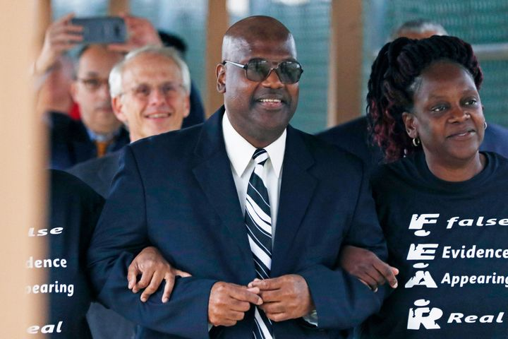 In this Monday, Dec. 16, 2019, file photo, Curtis Flowers, flanked by sister Priscilla Ward, exits the Winston Choctaw Region