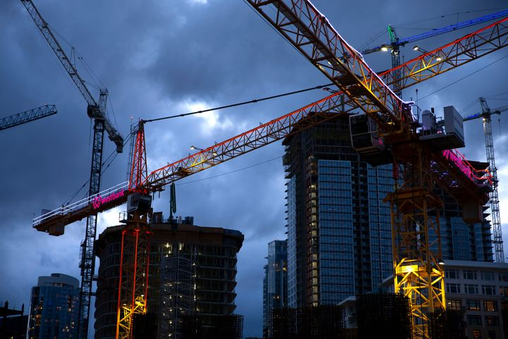 Tower cranes crisscross the sky on April 2, 2020, in Seattle. Cities across the country enlisted more officials from sustaina