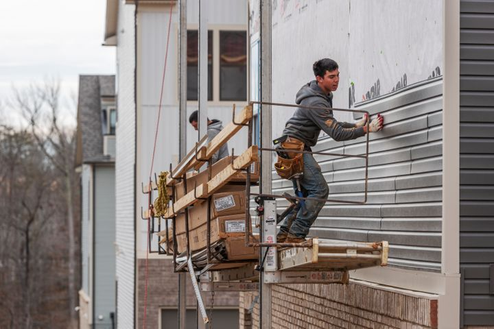 Construction workers in Laurel, Maryland, on Feb. 6, 2020.Buildings use roughly 40% of all energy produced in the U.S. for heating, power and cooking appliances, and generate a proportional share of the country's planet-heating gases.