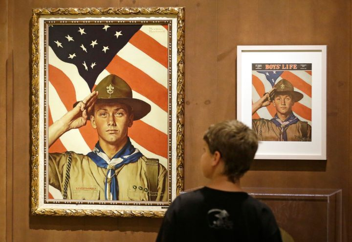 In this July 22, 2013, file photo, a youth looks over the Rockwell exhibition in Salt Lake City.