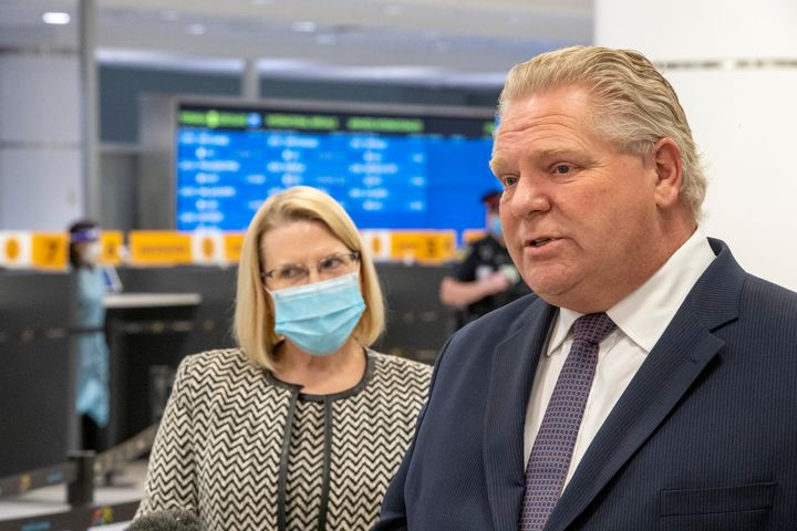 Ontario Premier Doug Ford and Solicitor General Sylvia Jones answer questions after touring the COVID-19 testing centre at Pearson Airport in Toronto on Feb. 3, 2021.