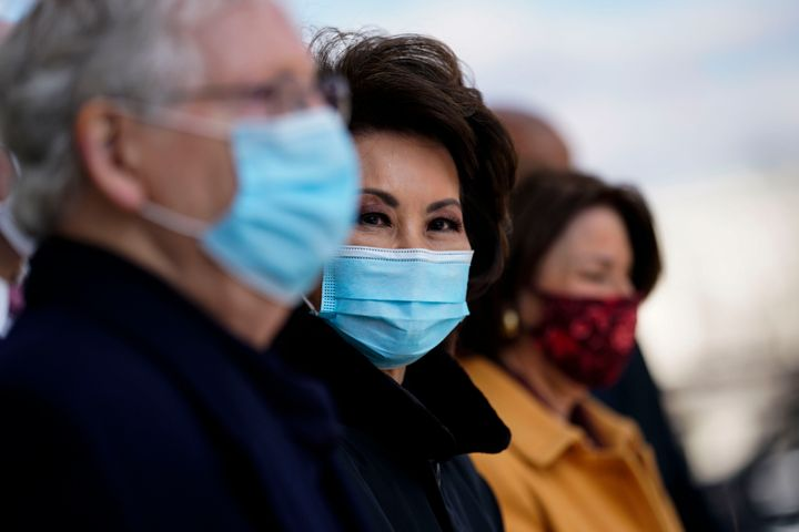 Sen. Mitch McConnell and former Secretary of Transportation Elaine Chao attend the inauguration of President Joe Biden on Jan