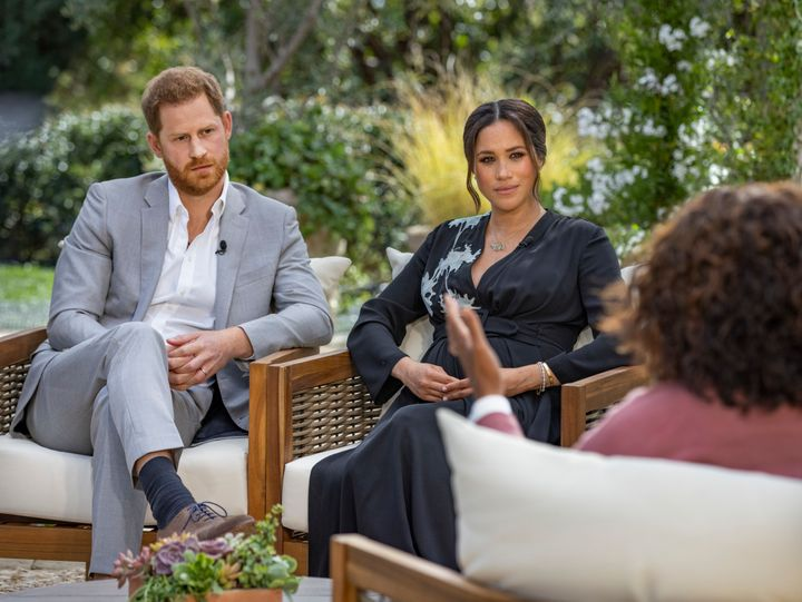 Prince Harry and Meghan, the Duke and Duchess of Sussex, in their interview with Oprah Winfrey, which airs Sunday.