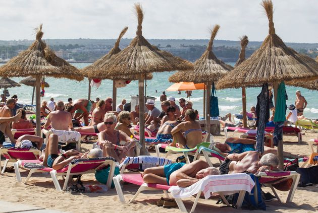 Tourists enjoy a sunny day in Palma de Mallorca in
