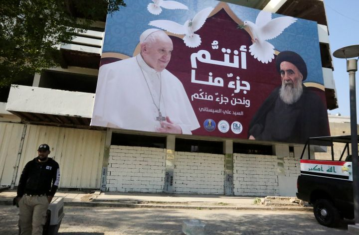 A giant billboard bears portraits of Pope Francis and Grand Ayatollah Ali Sistani in Baghdad on March 3, 2021 ahead of the fi