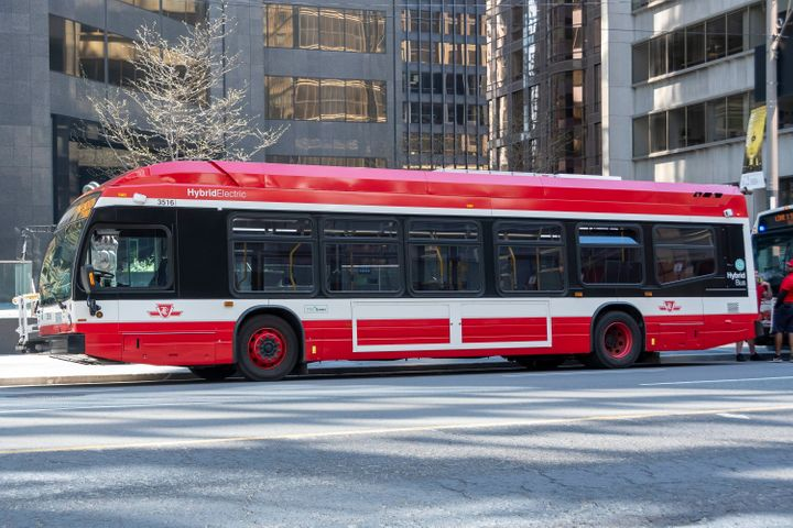 A TTC hybrid electric bus is seen waiting on University Avenue in Toronto on May 24, 2020.