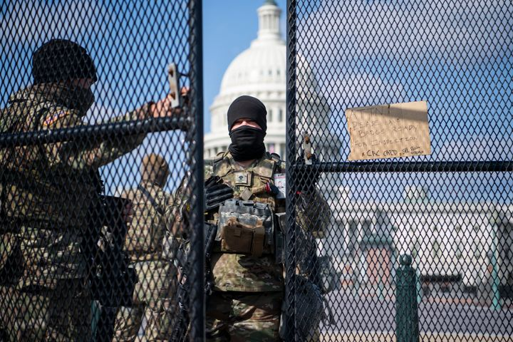 National Guard troops patrol the East Front of the Capitol on March 4, 2021.